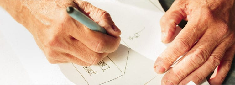 2_hands_drawing_house